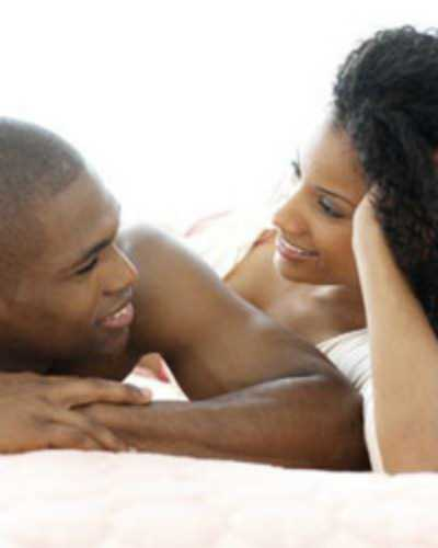 black-couple-talking-in-bed-1