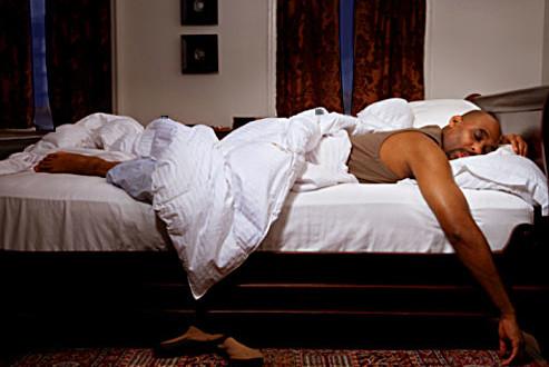 black-man-sleeping-in-bed-493x330
